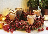 An Advent wreath for birds with rose hips and bird food