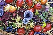 Autumn arrangement with rosehips and globe thistles