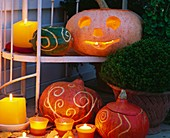 Carved pumpkins and gourds for Halloween
