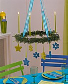 Hanging cypress Advent wreath with candles and stars