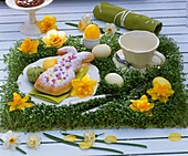 Cress table mat with narcissi, Easter eggs & baked Easter Bunny