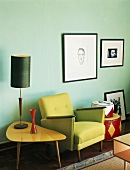 Green chair with side table and table lamp in retro style