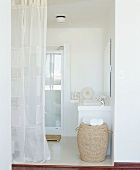 View into a bathroom with curtain
