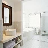 View into bathroom with wash basin & bath