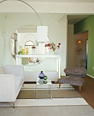 Sitting room with easy chair, couch and hanging lamp