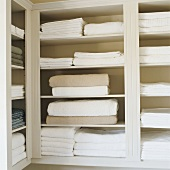 Towels and sheets on shelves