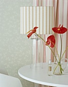 Flowers and a table lamp on a table