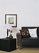 A leather and rattan couch with cube
