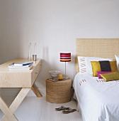 A desk beside a bed