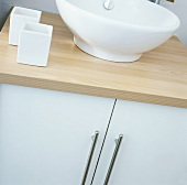 A wash basin on a cabinet
