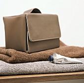 A sponge bag on towels