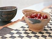 Cherries in a terracotta bowl