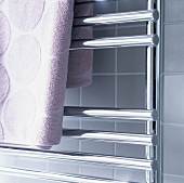 Bath towel hanging on a heated towel rail