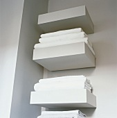 White bath towels on shelves