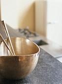 Gold bowl with chopsticks