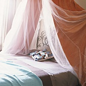 A bed with a canopy