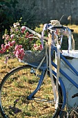 A bicycle with a basket filled with flowers
