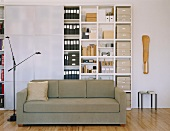 Couch in front of large office cupboard with sliding doors