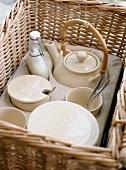Coffee crockery in a picnic basket