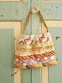 Bag hanging from wardrobe