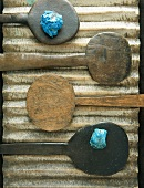 Four antique wooden spoons