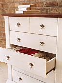 White chest of drawers with one drawer open