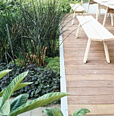 Terrace with wooden table & wooden benches in gardens