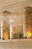 Storage jars by candle light