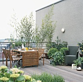Set table and plants on terrace