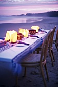 Set table on beach at twilight