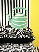 Teapot on black and white cushion