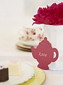 A place card in the shape of a teapot