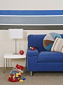 Blue couch, table and table lamp