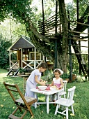 Two children playing in garden