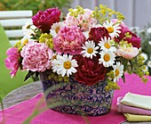 Arrangement of peonies, marguerites, lady's mantle