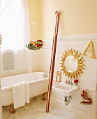 Traditional bathroom with free-standing bathtub and gilt accessories