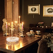 Christmas table and decorations in candlelight