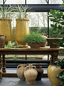 Ceramic pots on rustic table