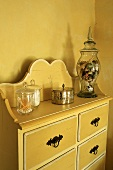 A chest of drawers with curved backboard