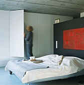 Woman opening built-in wardrobe in bedroom