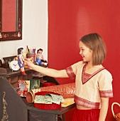 Girl playing with rag dolls