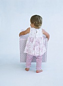 Little girl carrying large box