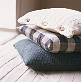 Stack of three different scatter cushions