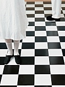 Feet on chequered floor