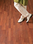 Person standing on parquet floor