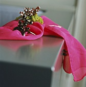 Jewellery on pink scarf