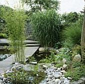 Garden with pond and footbridge