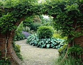 View into garden through round arch