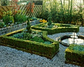 Garden with box hedges and fountain