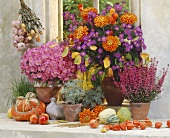 Still life with autumn flowers and squashes